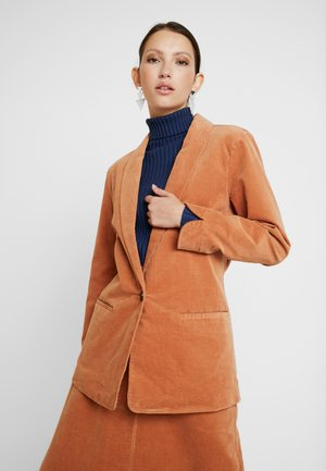 Krátký kabát - arganoil