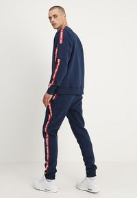 Alpha Industries - JOGGER TAPE - Tracksuit bottoms - new navy - 2