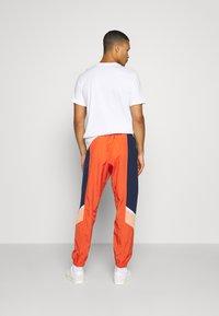 Nike Sportswear - Tracksuit bottoms - mantra orange/obsidian/orange frost - 2