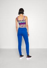 Versace Jeans Couture - PANTS - Tracksuit bottoms - blue - 2