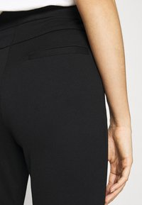 Vero Moda - VMAIDY ANKLE - Leggings - Trousers - black - 4