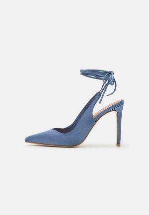 DECOLLETE ALTO ALLACCIATA CAVIGLIA - Lace-up heels - denim