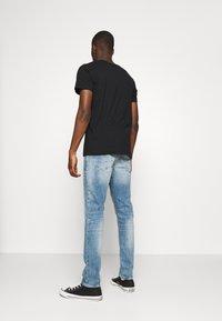 G-Star - 3301 STRAIGHT TAPERED - Straight leg jeans - ight-blue denim - 2