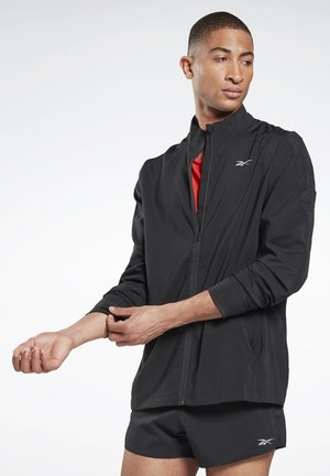 RUNNING ESSENTIALS WOVEN WINDBREAKER - Wiatrówka - black