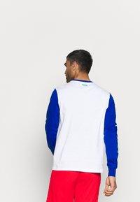 Puma - NBA 2K LONG SLEEVE - Long sleeved top - white - 2