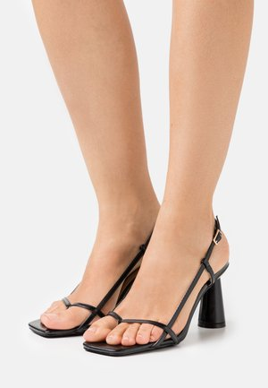 JESSY - T-bar sandals - black
