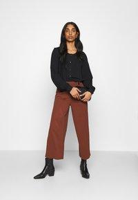 JDY - JDYGEGGO NEW ANCLE PANTS - Trousers - cherry mahogany/black - 1