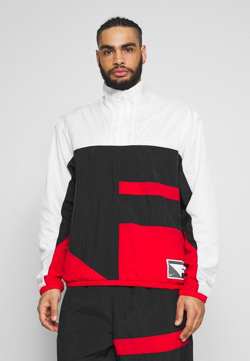 Nike Performance - FLIGHT TRACKSUIT - Tuta - black/white/university red