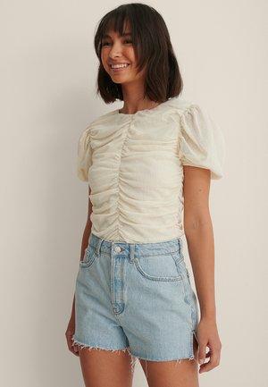 SIDE SLIT - Denim shorts - light blue