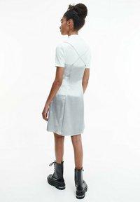 Calvin Klein Jeans - METALLIC SATIN SLIP - Cocktail dress / Party dress - silver - 2