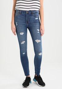 Hollister Co. - STRECH HIGH RISE SUPER SKINNY  - Jeans Skinny Fit - medium wash - 0