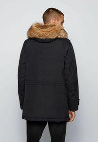BOSS - OCOOLIO - Down coat - black - 2