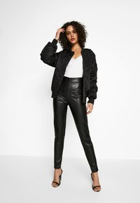 Nly by Nelly - ON POINT PANTS - Leggings - black - 1
