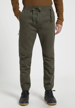 Tracksuit bottoms - mottled green