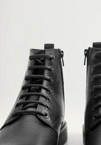 Mango - Lace-up ankle boots - black - 5