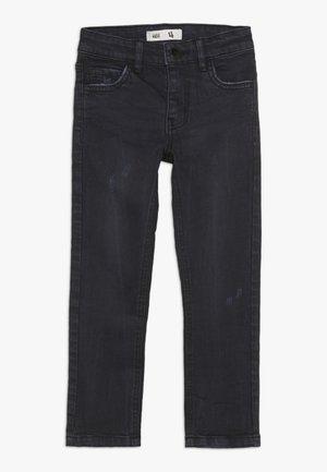 OLLIE  - Slim fit jeans - black