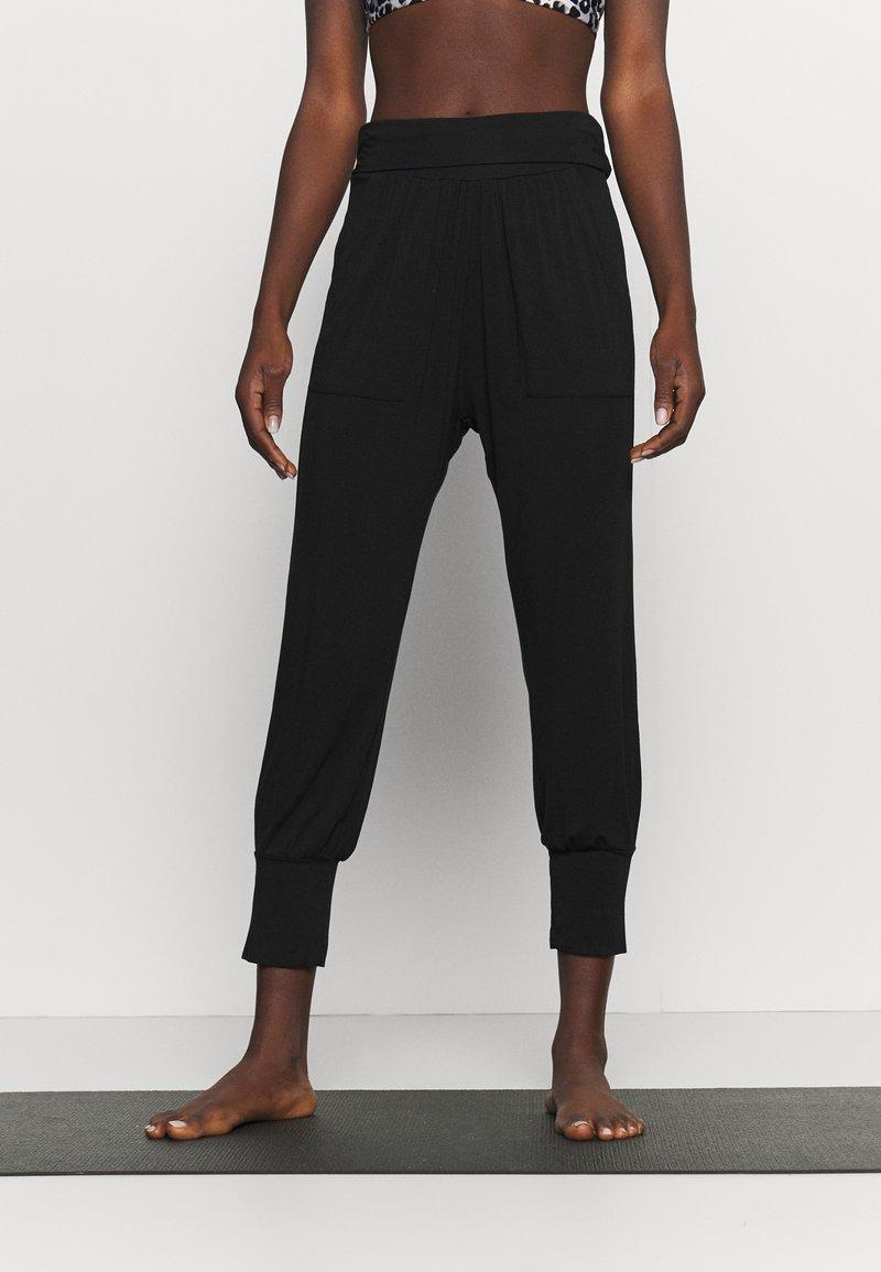 Deha - YOGA PANTS - Tracksuit bottoms - black