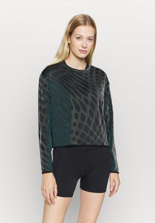 RUN DIVISION HOLOKNIT  - T-shirt de sport - black/green abyss