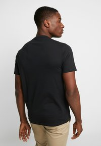 GAP - ARCH TEE - Triko s potiskem - moonless night - 2