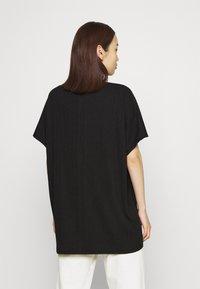 Monki - Camiseta estampada - black - 2