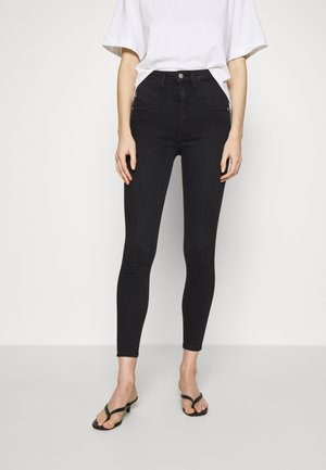 HIGH RISE SUPER SKINNY ANKLE - Jeans Skinny - washed black yoke
