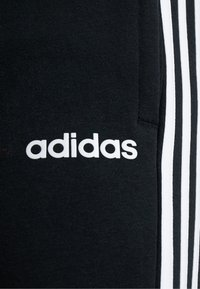 adidas Performance - Tracksuit bottoms - black/white - 5