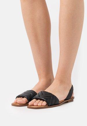 GRIRAWIAFLEX - Sandals - black
