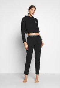 Calvin Klein Underwear - LOUNGE SLEEP PANT - Pyjama bottoms - black - 1