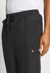 Ellesse - STOREO - Pantalones deportivos - black - 4