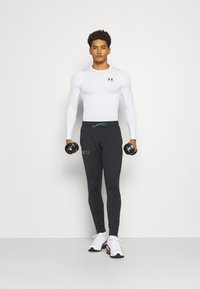 Under Armour - Camiseta de deporte - white // black - 1