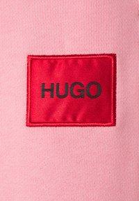 HUGO - DICHIBI REDLABEL - Tracksuit bottoms - bright pink - 2