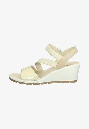 Sandalen met sleehak - gold/beige