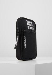 Superdry - SPORT POUCH - Across body bag - black - 4