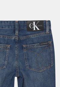 Calvin Klein Jeans - REGULAR STRAIGHT - Straight leg jeans - blue - 3