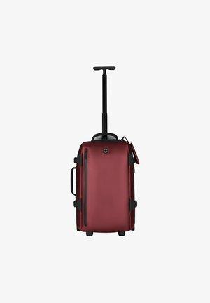 Wheeled suitcase - beetroot coated
