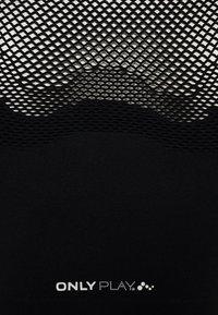 ONLY PLAY Tall - ONPADELYNN CIRCULAR SPORTS BRA - Top - black - 2