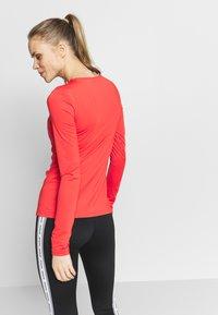 Nike Performance - ALL OVER - Koszulka sportowa - track red/white - 2