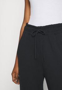 Nike Sportswear - Jogginghose - black/black - 7
