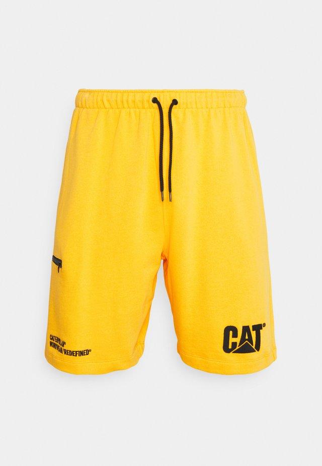 CAT MACHINERY - Kraťasy - yellow