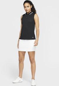 Nike Golf - DRY VICTORY - Sports shirt - black/white - 1