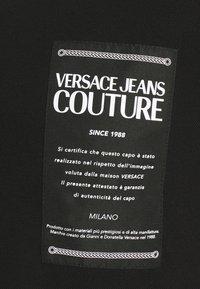 Versace Jeans Couture - PLAIN - Polo shirt - black - 6