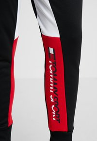 Tommy Sport - GRAPHIC LOGO CUFF - Tracksuit bottoms - black - 3