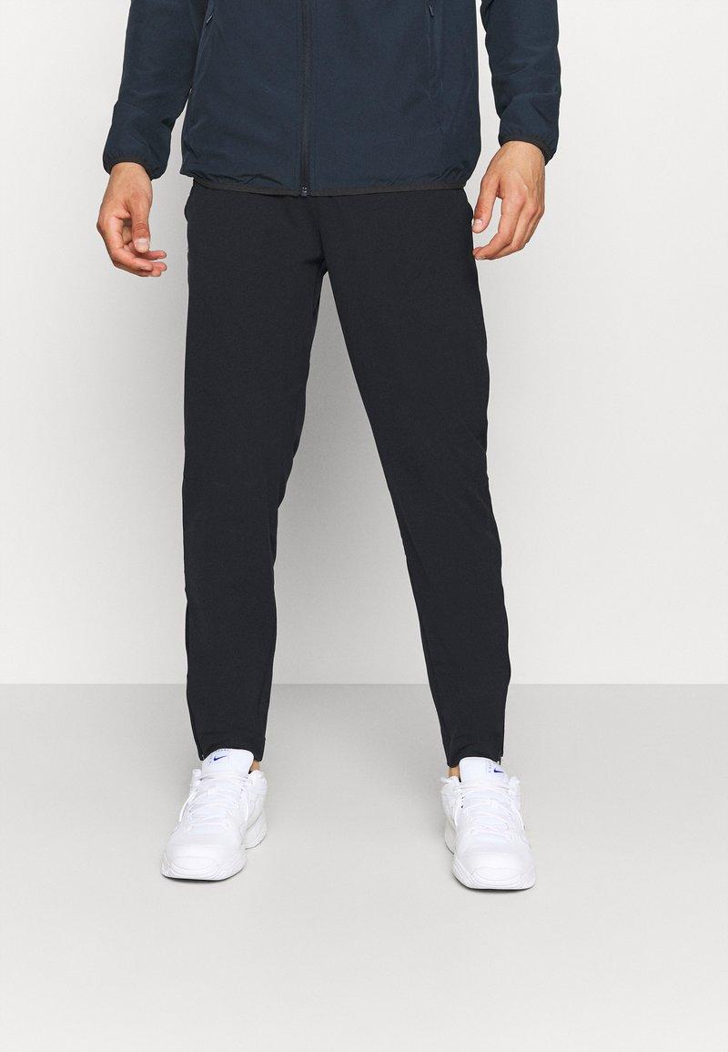Lacoste Sport - NAMING TRACK PANT - Teplákové kalhoty - black/white