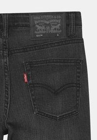 Levi's® - PERFORMANCE  - Denim shorts - black denim - 2