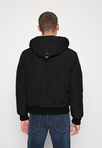 Superdry - EVEREST - Winter jacket - black - 3