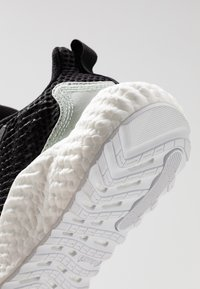 adidas Performance - ALPHABOOST PARLEY - Neutral running shoes - core black/linen green/footwear white - 5