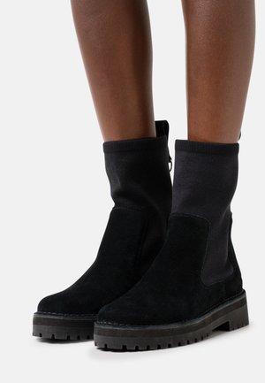 ROCK - Platform ankle boots - black