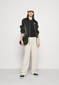 Nike Sportswear - AIR SHEEN - Summer jacket - black/white - 1