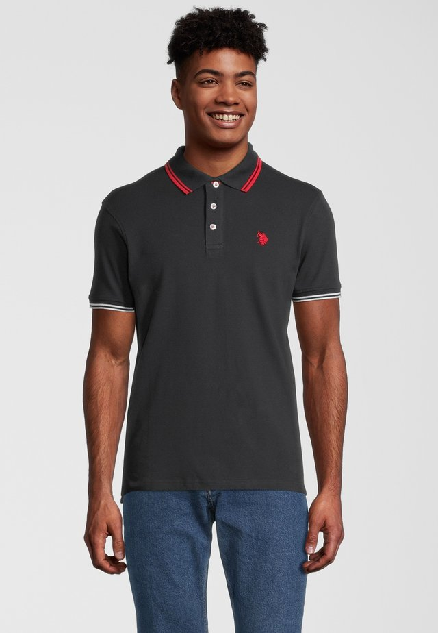 BARNEY - Polo shirt - black