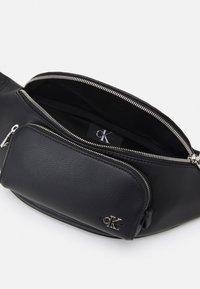 Calvin Klein Jeans - WAISTBAG FRONT POCKET UNISEX - Bum bag - black - 2